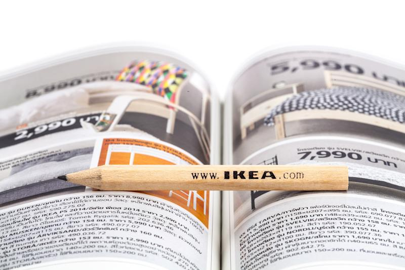 Songkhla, Thailand - January 27, 2015: Ikea pencil placed between the central ridge of the Ikea catalog walleye edition Thailand . Ikea Founded in Sweden in 1943, Ikea is the world's largest furniture retailer.