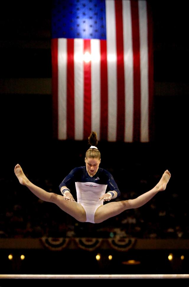 376864 02: American gymnast Elise Ray competes on the uneven bars August 20, 2000 during the U.S. Gymnastics Olympic Trials in Boston. Maloney earned a spot on the U.S. gymnastics team that will compete in the 2000 Summer Olympics in Sydney, Australia. (Photo by Brian Snyder)