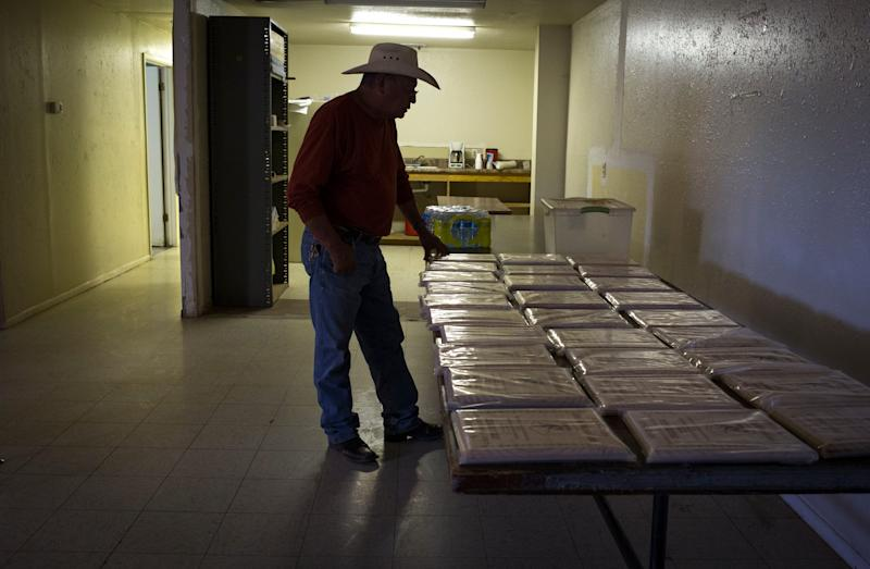 Jerry Zilth, who is retiring after 43 years, looks at retirement plaques on July 9, 2019, before the start of UMWA Local 1924 monthly meeting in Page, Arizona.