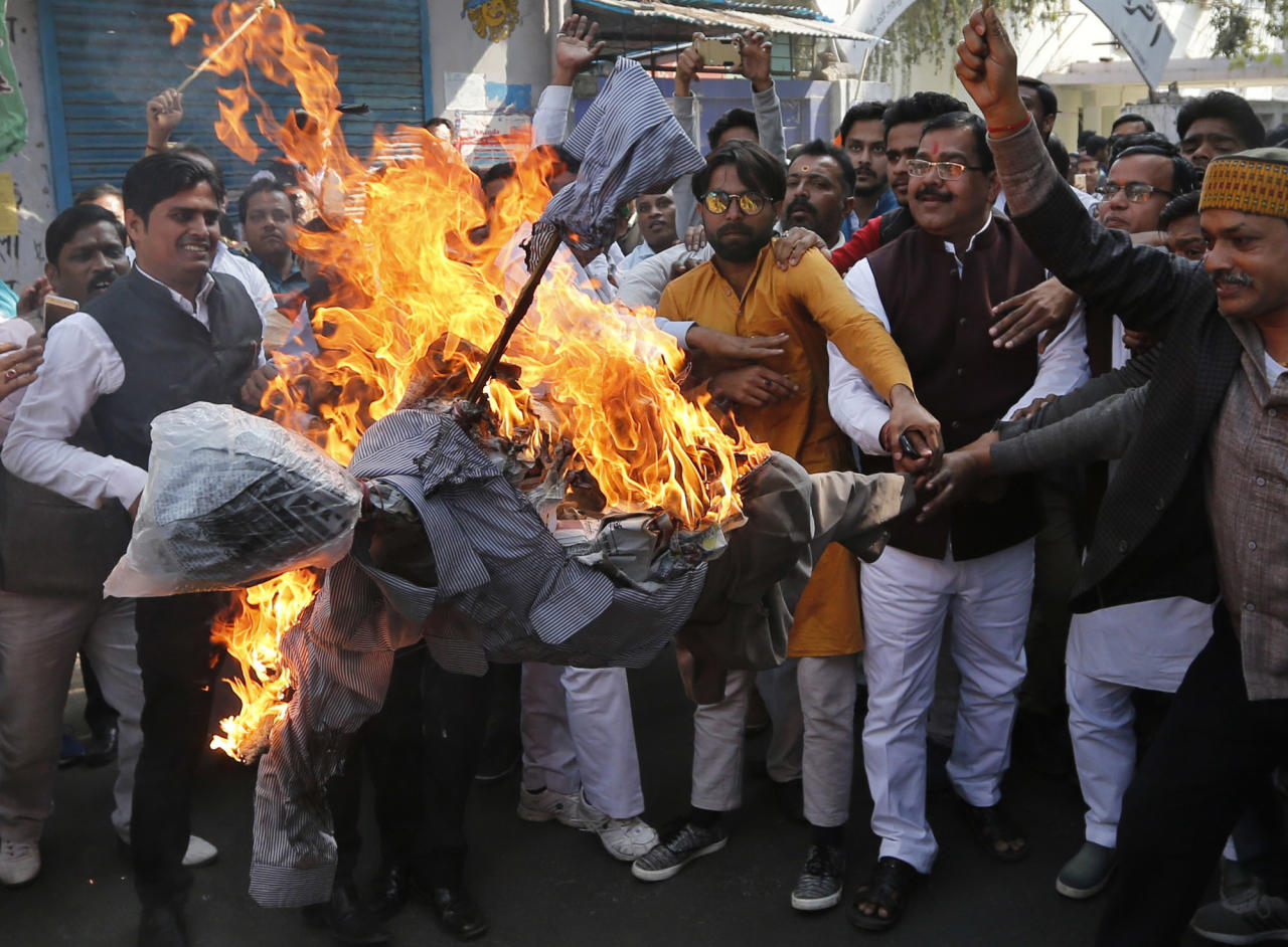 India's opposition Congress party supporters shout slogansas they burn an effigy of Prime Minister Narendra Modi as they protest against the alleged $1.8 billion bank fraud in Lucknow, India, Tuesday, Feb. 20, 2018. (AP Photo/Rajesh Kumar Singh)