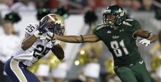 Pittsburgh defensive back Jason Hendricks (25) intercepts a pass intended for South Florida wide receiver Andre Davis (81) during the first quarter of an NCAA college football game Saturday, Dec. 1, 2012, in Tampa, Fla. (AP Photo/Chris O'Meara)