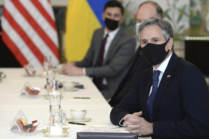 United States Secretary of State Antony Blinken, right, waits for the start of a meeting with Ukrainian Foreign Minister Dmytro Kuleba in Brussels, Tuesday, April 13, 2021. (Johanna Geron, Pool via AP)