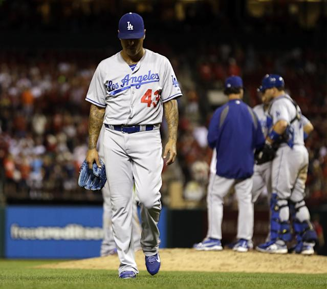 Los Angeles Dodgers relief pitcher Brandon League walks off the field after being removed from a baseball game against the St. Louis Cardinals in the eighth inning on Tuesday, Aug. 6, 2013, in St. Louis. (AP Photo/Jeff Roberson)