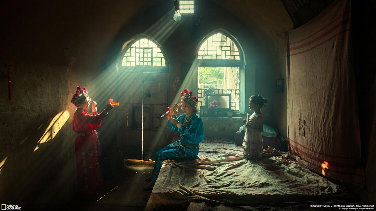Winner of the 'People' category was Huaifeng Li with 'Showtime', depicting actors preparing for an evening opera performance in Licheng County, China. [Photo: National Geographic Travel Photo Contest]