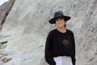 Nebraska volleyball player Lexi Sun is seen wearing a sweatshirt with her name on it in Encinitas, Ca., on June 19, 2021. Sun wanted her deal with volleyball apparel company Ren Athletics to allow her personality and style to shine through in the launch of her clothing line — a black sweatshirt with her name and a golden outline of the sun's rays. It quickly sold out. (Natalie Hagglund via AP)