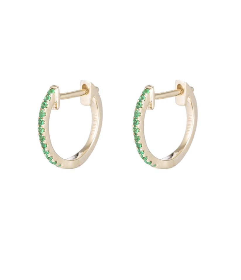 """<p>14-karat yellow gold-and-emerald pavé huggies, $695, <a rel=""""nofollow"""" href=""""https://www.arielgordonjewelry.com/collections/earrings/products/emerald-pave-huggies"""">arielgordonjewelry.com</a> </p>"""