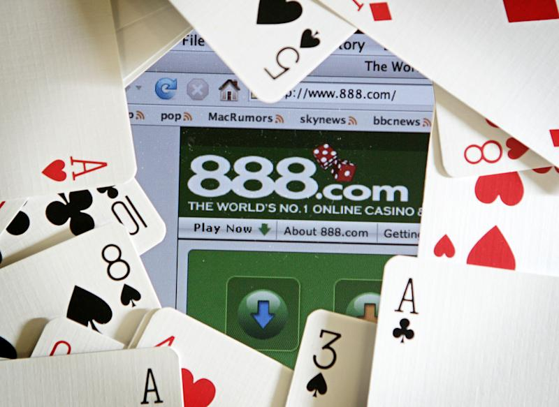 The online gambling website of 888 holdings is pictured surrounded by a deck of cards in London on November 6, 2006