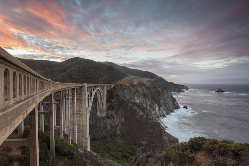 Completed in 1932, the Bixby Bridge is one of the highest bridges of its kind in the world and makes for a stunning sunset snap. Photo: Getty