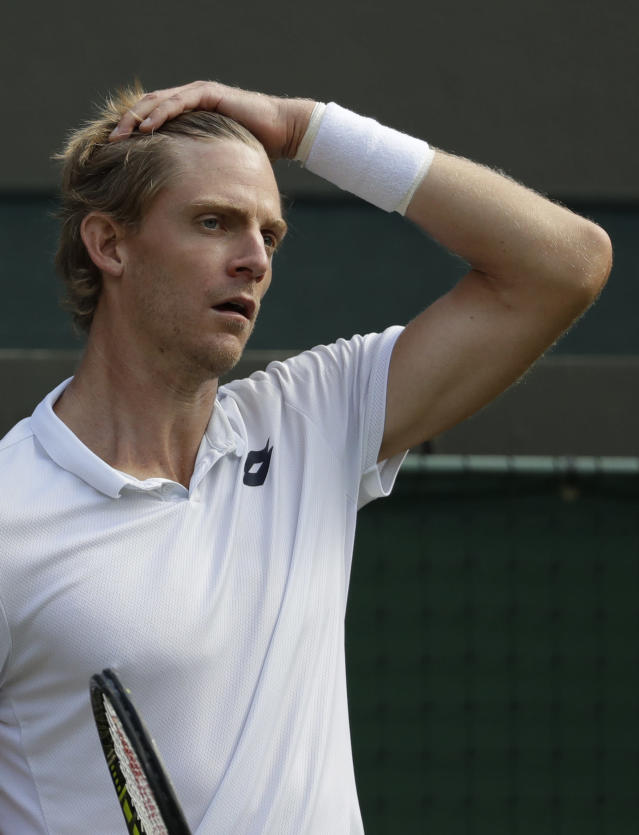 Kevin Anderson of South Africa reacts after losing a point in his men's quarterfinals match against Switzerland's Roger Federer, at the Wimbledon Tennis Championships, in London, Wednesday July 11, 2018. (AP Photo/Ben Curtis)