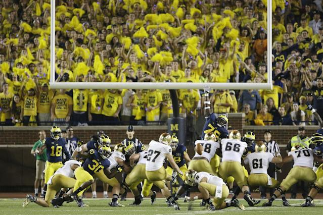 Notre Dame kicker Kyle Brindza (27) makes a field goal during the second quarter of an NCAA college football game against Michigan in Ann Arbor, Mich., Saturday, Sept. 7, 2013. (AP Photo/Carlos Osorio)