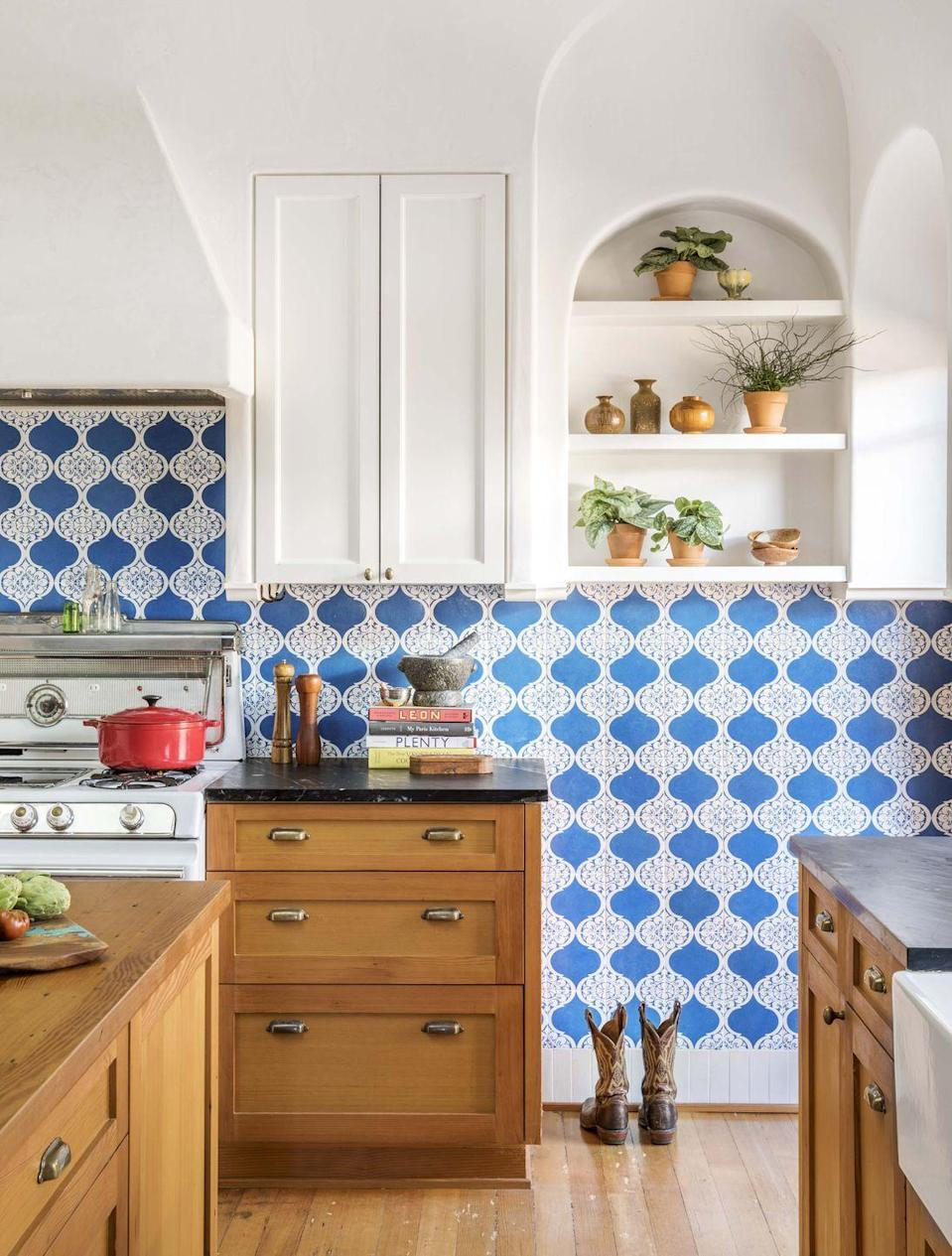 "<p>Try a bold tile to bridge the transition between a darker and lighter colors. We're obsessed with the blue encaustic tile in <a href=""https://www.housebeautiful.com/design-inspiration/home-makeovers/a25647683/dark-kitchen-reclaimed-wood-before-after/"" rel=""nofollow noopener"" target=""_blank"" data-ylk=""slk:this kitchen"" class=""link rapid-noclick-resp"">this kitchen </a>by Steve Pallrand, especially when warmed up by classic wood cabinets and a little plant collection. </p>"