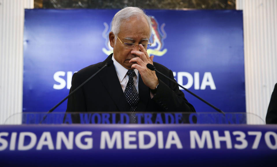 Then Malaysian Prime Minister Najib Razak pauses before speaking at a news conference announcing the findings for the ill-fated flight Malaysia Airlines Flight 370 in Kuala Lumpur, Malaysia, on Aug. 6, 2015. Najib was found guilty Tuesday, July 28, 2020 in his first corruption trial linked to one of the world's biggest financial scandals - the billion-dollar looting of the 1MDB state investment fund. (AP Photo/Vincent Thian)