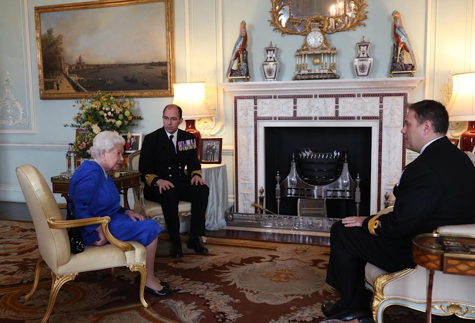 Queen Elizabeth II receives Commodore Steven Moorhouse (right, outgoing Commanding Officer, HMS Queen Elizabeth) and Captain Angus Essenhigh (incoming Commanding Officer), during a private audience in the Queen's Private Audience Room, at Buckingham Palace, London. PA Photo. Picture date: Wednesday March 18, 2019. Photo credit should read: Yui Mok/PA Wire