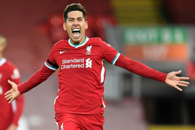 Just in time: Roberto Firmino's 90th-minute winner took Liverpool top of the Premier League