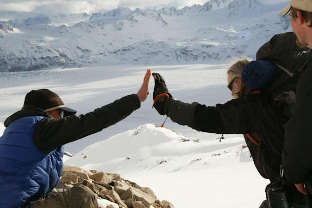 Tordrillo Mountains, Alaska, USA: Tyrell Seave high-fiving Willi Prittie.