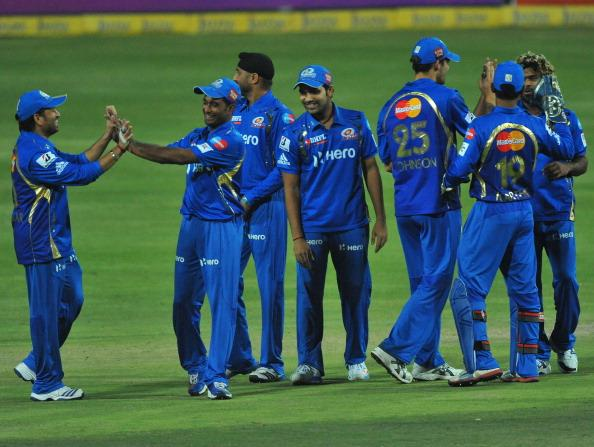 JOHANNESBURG, SOUTH AFRICA - OCTOBER 14:  Mumbai players celebrate capturing the wicket of Alviro Petersen (not pictured) of the Lions for 14 runs during the Karbonn Smart CLT20 match between Highveld Lions and Mumbai Indians at Bidvest Wanderers Stadium on October 14, 2012 in Johannesburg, South Africa.  (Photo by Duif du Toit/Gallo Images/Getty Images)