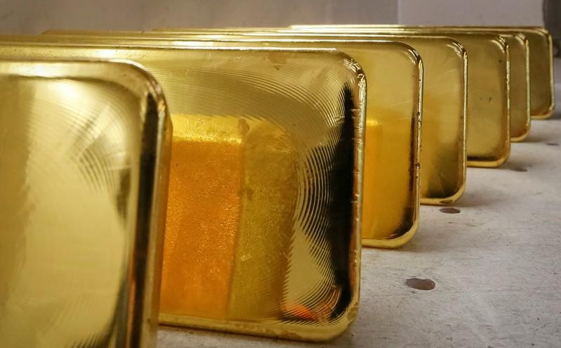 Gold gains as weak China data dents risk appetite