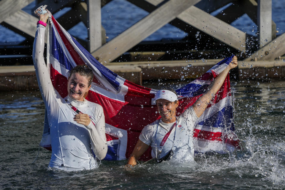 Great Britain's Hannah Mills, right, and Eilidh Mcintyre celebrate after winning the 470 women's gold medal