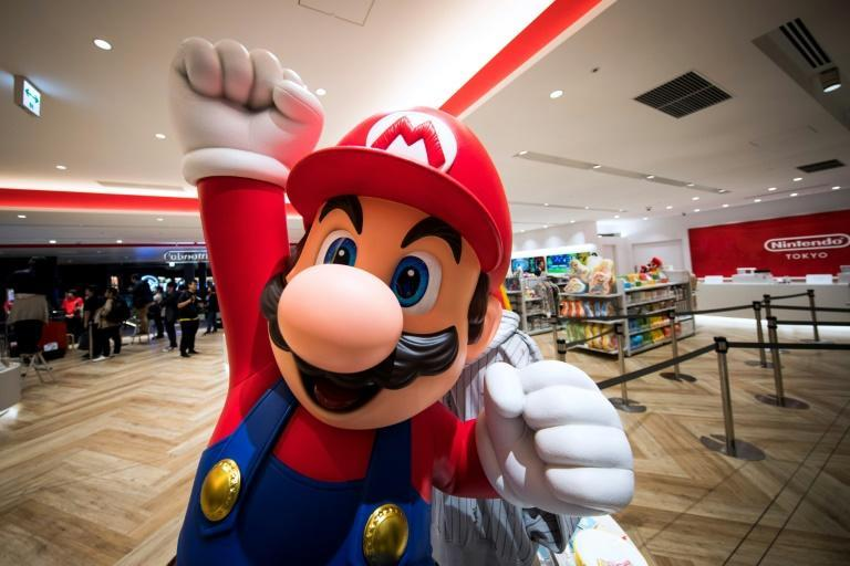 "A real-life ""Super Mario"" game and a ""Mario Kart"" ride will open next spring at Universal Studios Japan"