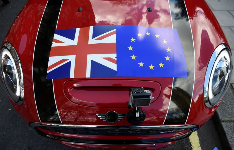 FILE PHOTO: A Mini car is seen with a Union flag and European Union flag design on its bonnet in London