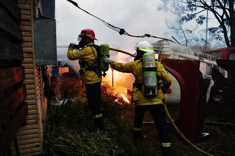 Rural Fire Service firefighters extinguish a fire on a property on January 23, 2020 in Moruya, Australia. (Photo by Sam Mooy/Getty Images) (Photo: Sam Mooy via Getty Images)