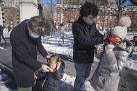 New York State Senator Brad Hoylman, left, with his husband David Sigal, right, mask their daughters Lucy Hoylman-Sigal, 3, left, and Silvia Hoylman-Sigal, 10, both born through surrogacy, Saturday Feb. 6, 2021, in New York. Sen. Hoylman is the lead sponsor of a New York State law taking effect on Feb. 15 that legalizes commercial surrogacy. (AP Photo/Bebeto Matthews)