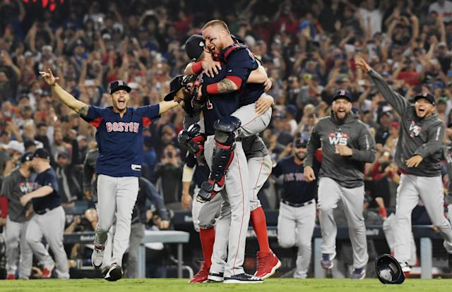 Christian Vazquez jumps into the arms of Chris Sale of the Boston Red Sox to celebrate their 5-1 win over the Los Angeles Dodgers in Game Five to win the 2018 World Series. (Getty)