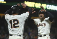 San Francisco Giants' Hunter Pence, right, celebrates with Joe Panik (12) after both scored against the San Diego Padres in the seventh inning of a baseball game Tuesday, Sept. 25, 2018, in San Francisco. (AP Photo/Ben Margot)