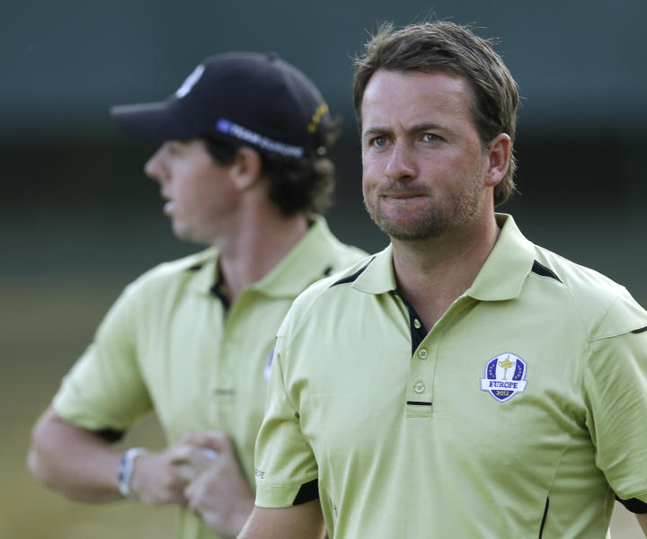 Europe's Graeme McDowell and Rory McIlroy walk off the 17th hole after losing 2&1 to USA's Phil Mickelson and Keegan Bradley during a four-ball match at the Ryder Cup PGA golf tournament Friday, Sept. 28, 2012, at the Medinah Country Club in Medinah, Ill. (AP Photo/David J. Phillip)