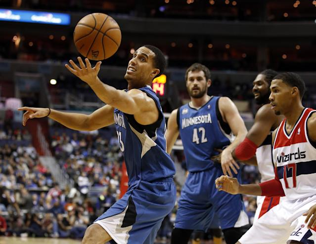 Minnesota Timberwolves guard Kevin Martin (23) grabs the loose ball in front of Washington Wizards guard Garrett Temple (17), with Timberwolves forward Kevin Love (42) behind, in the first half of an NBA basketball game Tuesday, Nov. 19, 2013, in Washington. (AP Photo/Alex Brandon)