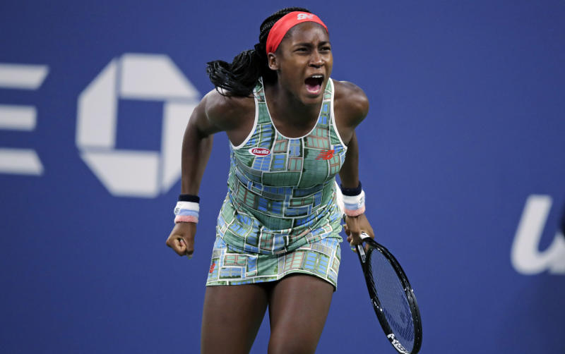 Coco Gauff. of the United States, celebrates after defeating Timea Babos, of Hungary, during the second round of the U.S. Open tennis tournament in New York, Thursday, Aug. 29, 2019. (AP Photo/Charles Krupa)
