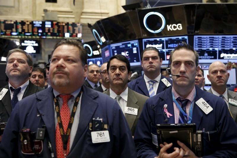 Traders on hold a moment of silence in response to the Paris attacks on the floor of the New York Stock Exchange