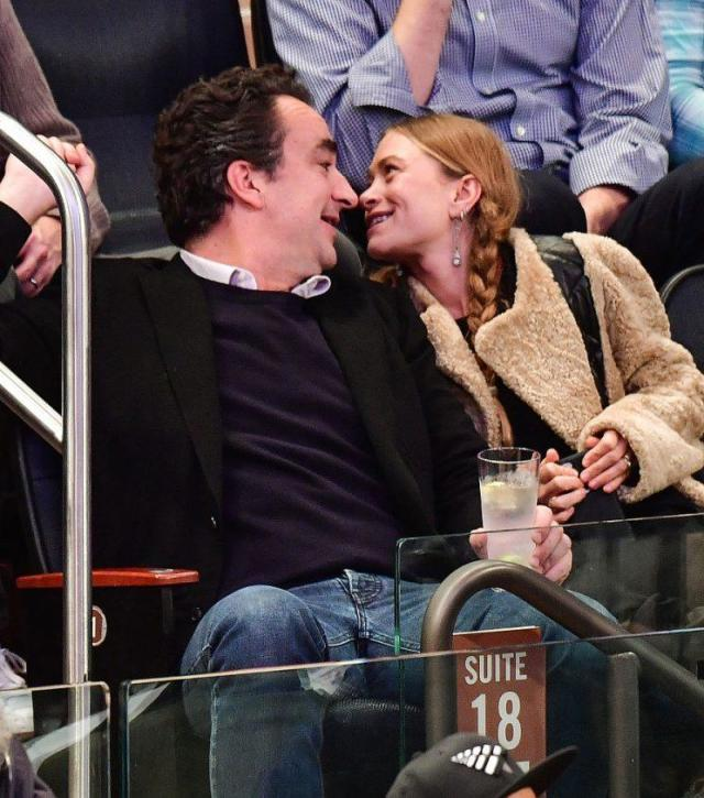 Mary-Kate Olsen rocking her statement pigtails while enjoying a basketball game with her hubby. (Photo: Getty Images)