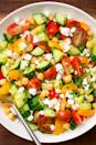 "<p>This bright, satisfying salad comes together in 10 minutes tops.</p><p>Get the recipe from <a href=""https://www.delish.com/cooking/recipes/a47400/tomato-cucumber-feta-salad-recipe/"" rel=""nofollow noopener"" target=""_blank"" data-ylk=""slk:Delish"" class=""link rapid-noclick-resp"">Delish</a>.</p>"