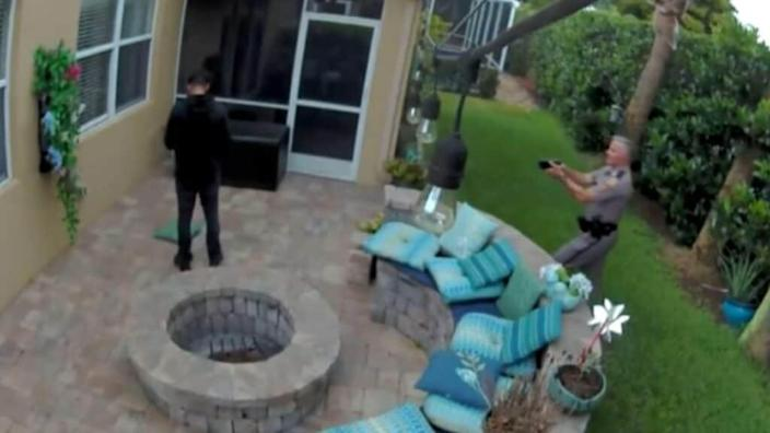 Trooper George Smyrnios (right) is seen on video approaching Jack Roseman (left) with his taser drawn. When the 16-year-old doesn't comply with the trooper's orders, he is tased. (CBS 4)