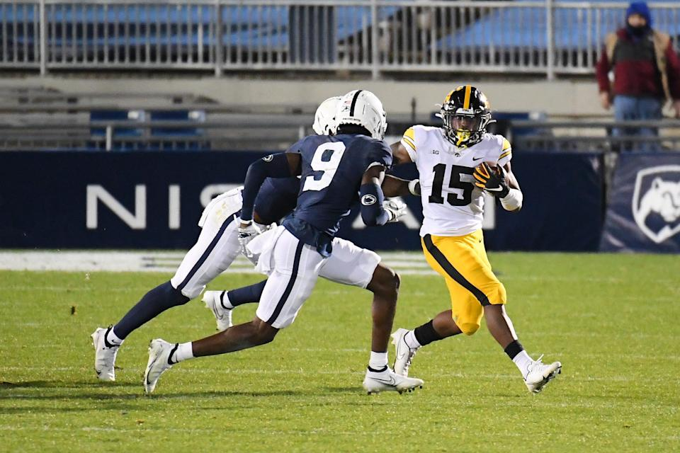 Iowa running back Tyler Goodson (15) runs with the ball as Penn State cornerback Joey Porter Jr. (9) defends during their game in 2020 at Beaver Stadium.