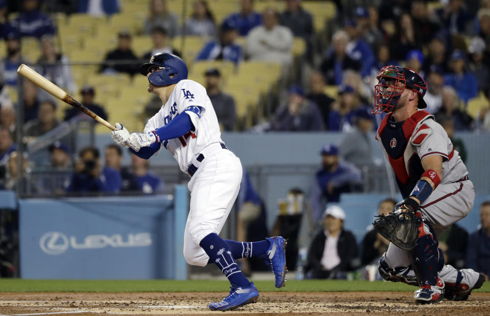Los Angeles Dodgers' Enrique Hernandez, left, watches his two-run home run against the Atlanta Braves during the second inning of a baseball game Wednesday, May 8, 2019, in Los Angeles. (AP Photo/Marcio Jose Sanchez)