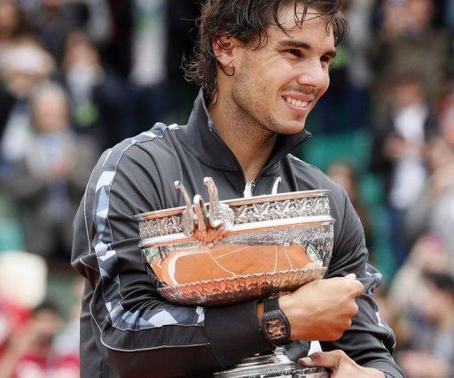 Spain's Rafael Nadal clutches his trophy after winning the French Open in Paris on Monday. Nadal clinched his record seventh French Open title on Monday, defeating world number one Novak Djokovic 6-4, 6-3, 2-6, 7-5 and shattering the Serb's dream of Grand Slam history
