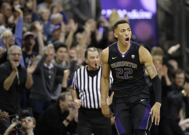 "Washington's <a class=""link rapid-noclick-resp"" href=""/ncaab/players/131328/"" data-ylk=""slk:Dominic Green"">Dominic Green</a> reacts after sinking a 3-point basket during the second half against Arizona in an NCAA college basketball game Saturday, Feb. 3, 2018, in Seattle. Washington won 78-75 with Green later hitting the tie-breaking shot in the final seconds. (AP Photo/John Froschauer)"