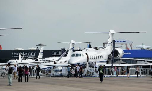 <p>Commercial planes on display at the Singapore Airshow on February 14, 2014</p>