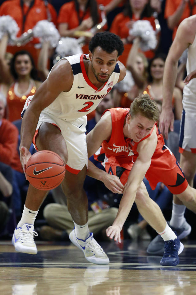 Virginia guard Braxton Key (2) steals the ball from Syracuse forward Marek Dolezaj (21) during the second half of an NCAA college basketball game in Charlottesville, Va., Saturday, Jan. 11, 2020. Syracuse defeated Virginia 63-55 in overtime. (AP Photo/Steve Helber)