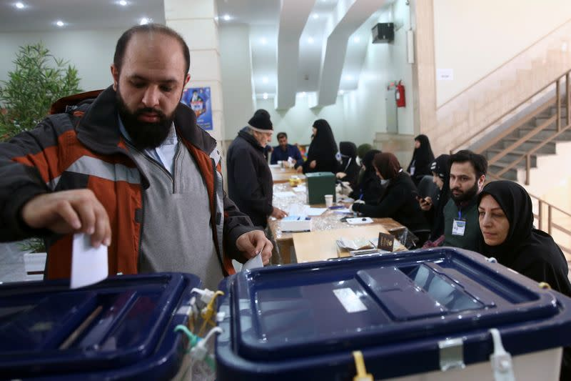 Man casts his vote during parliamentary elections at a polling station in Tehran
