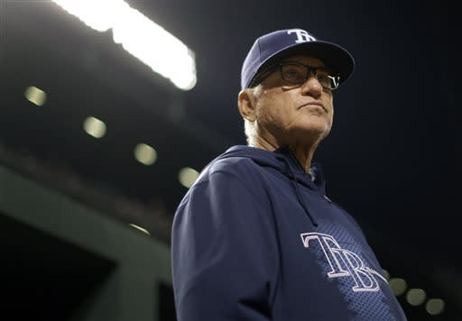 Tampa Bay Rays manager Joe Maddon watches from the dugout in the fourth inning of a baseball game against the Baltimore Orioles on Tuesday, April 16, 2013, in Baltimore. (AP Photo/Patrick Semansky)