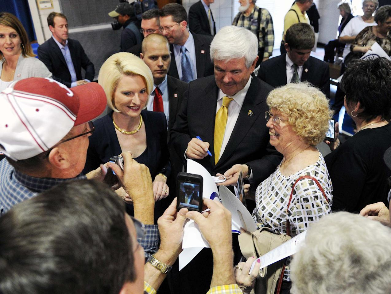 Republican presidential candidate Newt Gingrich and wife Callista sign autographs for supporters after a rally at the Pell City Civic Center Wednesday, March 7, 2012 in Pell City, Ala. (AP Photo/The Birmingham News, Hal Yeager) MAGS OUT