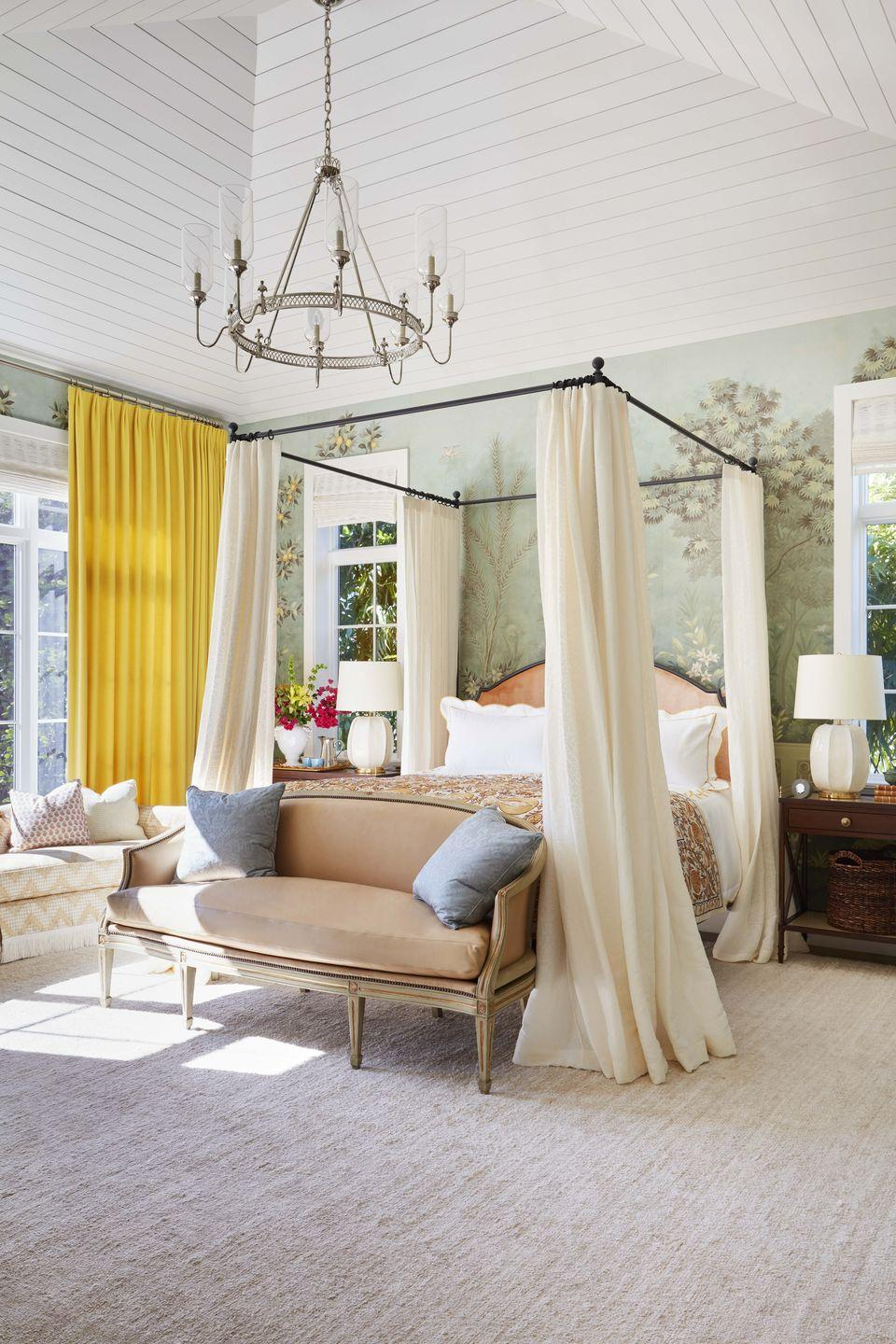 "<p>This sun-drenched bedroom resides in a <a href=""https://www.veranda.com/decorating-ideas/house-tours/a35369885/summer-thornton-naples-house-tour-2021/"" rel=""nofollow noopener"" target=""_blank"" data-ylk=""slk:Naples, Florida vacation home"" class=""link rapid-noclick-resp"">Naples, Florida vacation home</a> masterfully decorated by <a href=""https://summerthorntondesign.com/"" rel=""nofollow noopener"" target=""_blank"" data-ylk=""slk:Summer Thornton"" class=""link rapid-noclick-resp"">Summer Thornton</a>. The Chicago-based designer makes the most of dramatically high ceilings in this primary bedroom suite, using an understated yet elegant chandelier to create a sophisticated glow. Bedside lamps are the perfect choice when a softer glow is needed while relishing the last pages of the latest book club pick. </p>"