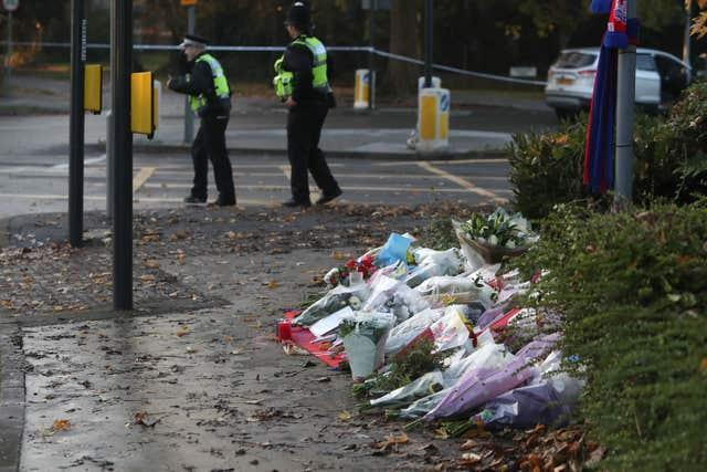 Flowers left at the scene after the tram crash in Croydon, Surrey (Steve Parsons/PA)