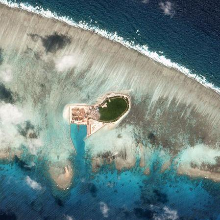 FILE PHOTO - Satellite photo shows Chinese-controlled Tree Island, part of the Paracel Islands group in the South China Sea, on October 12, 2017. Planet Labs/Handout via REUTERS