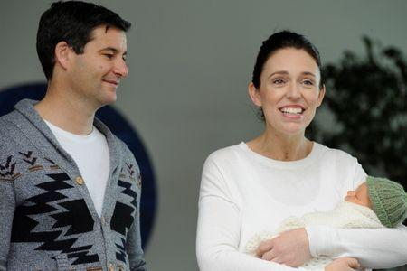 New Zealand Prime Minister Jacinda Ardern carries her newborn baby Neve Te Aroha Ardern Gayford with her partner Clarke Gayford as she walks out of the Auckland Hospital in New Zealand, June 24, 2018.  REUTERS/Ross Land