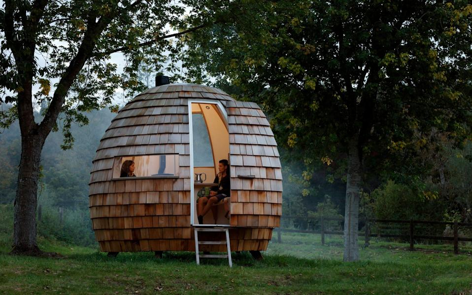 The escape pod, an ellipsoid room clad in cedar shingles and made using birch ply and oak by Podmakers, from £19,800