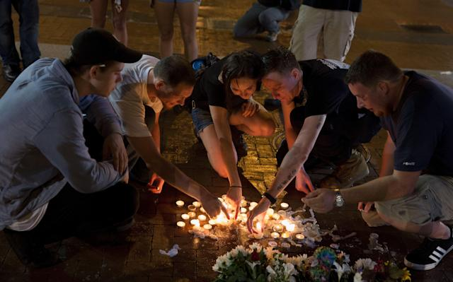 <p>People place candles as they gather during a vigil in Charlottesville, Virginia, USA, 12 August 2017. According to media reports at least one person was killed and 19 injured after a car hit a crowd of people counter-protesting the 'Unite the Right' rally which was scheduled to take place in Charlottesville on 12 August. At least 15 others were injured in clashes during protests. (Tasos Katopodis/EPA/REX/Shutterstock) </p>